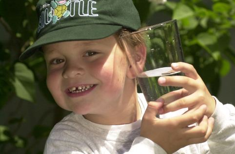 boy_with_glass_of_water_2000_4493850909